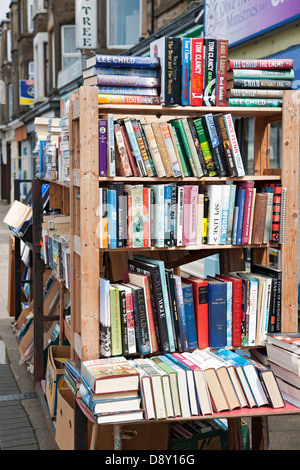 Books for sale outside secondhand bookshop Morecambe Lancashire England UK United Kingdom GB Great Britain - Stock Photo