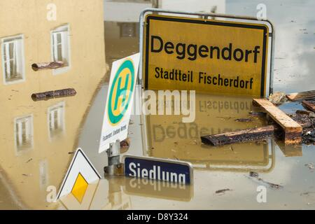 Deggendorf, Germany, 6 June 2013. A place-name sign stands submerged in the floodwater of the River Danube in Deggendorf, - Stock Photo
