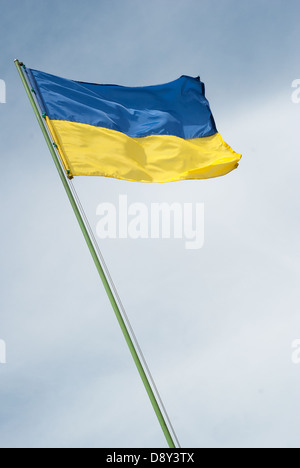 Flag of Ukraine against the blue sky - Stock Photo