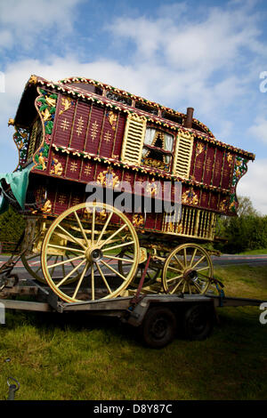 Appleby, Cumbria, Uk. 6th June, 2013.  Finely decorated Vardo or Bow Top wagon, rural trailer home,  en-route to - Stock Photo
