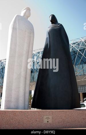Black & White Granite Sculpture of Arab Man & Woman Together by Lutfi Romhein - Stock Photo