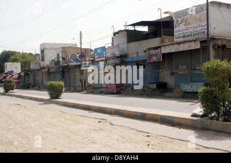 Shops seen closed during strike in connection of Mourn Day called by Muttahida Qaumi Movement (MQM) against target - Stock Photo