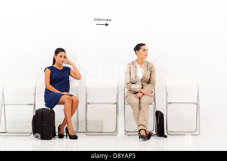 two beautiful female candidates waiting for job interview - Stock Photo