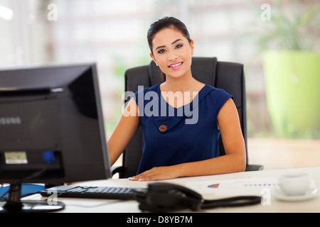 portrait of young indian manager in her modern office - Stock Photo