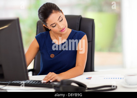 beautiful young businesswoman working in her modern office - Stock Photo