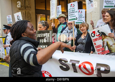 Protesters outside the AGM of security multinational G4S demonstrates against the company's involvement in Israeli - Stock Photo