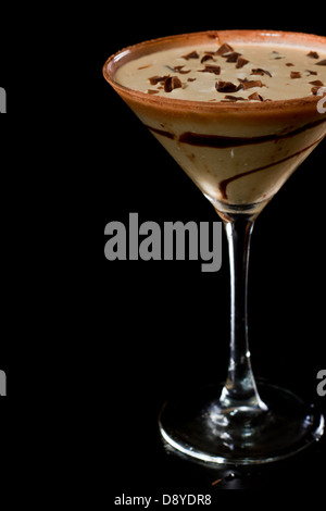 chocolate martini isolated on a black background with chocolate swirl and cocoa powder on the rim - Stock Photo