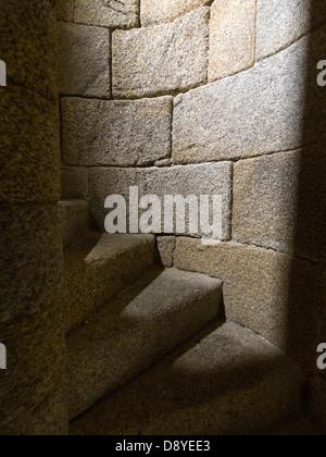 Narrow stone spiral staircase - Stock Photo