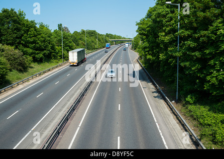 A12 Essex, UK. Vehicles using the outside lane on dual carriageway when no traffic is in nearside lane. - Stock Photo