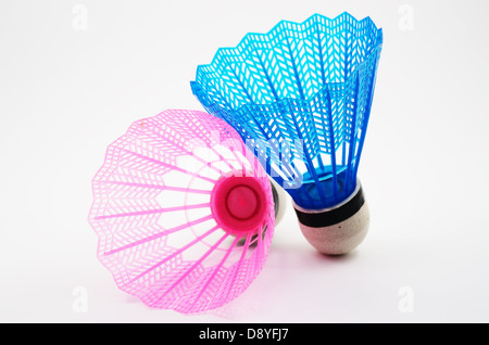 pink and blue badminton shuttlecocks on a white background - Stock Photo