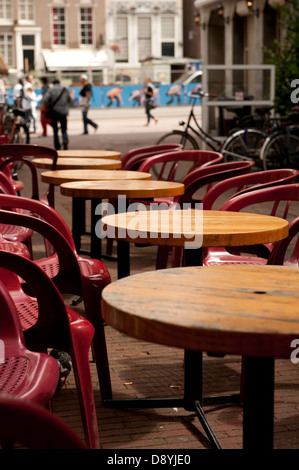 Empty street cafe tables Amsterdam Holland Netherlands Europe - Stock Photo
