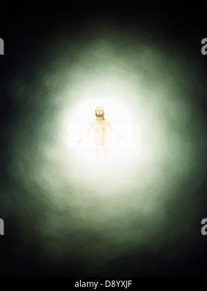 A Christ figure in a light. - Stock Photo