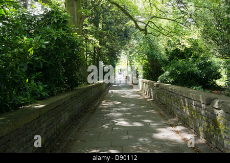 The path through the gardens in the middle of Victoria Square, Clifton, Bristol. - Stock Photo
