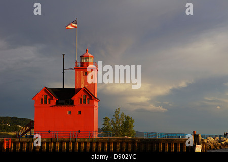 Big Red lighthouse in Holland, Michigan at sunset after a thunderstorm Stock Photo