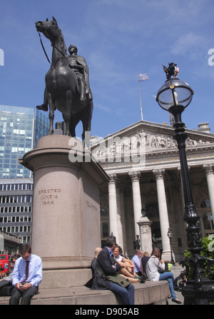 The Royal Exchange and Duke of Wellington statue London - Stock Photo