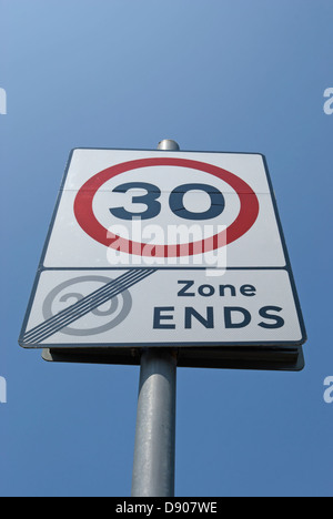 british road sign indicating end of 20mph zone and start of 30mph zone