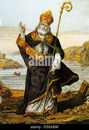 ST PATRICK  (c 387-460) Romano-British Christian missionary in an early 19th century print showing him trampling - Stock Photo