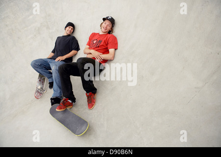 Two scandinavian men in a skateboardpark, Malmo, Sweden. - Stock Photo