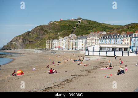 Aberystwyth Wales UK, Friday 7 June 2013.   With temperatures reaching 24 degrees centigrade  tourists and local - Stock Photo