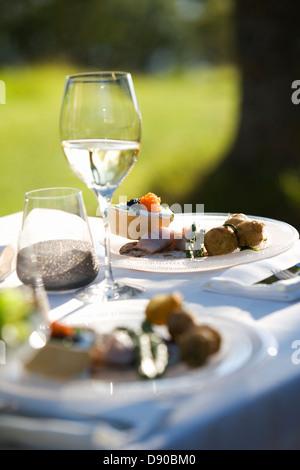 Midsummer party, plates on a table, Fejan, Stockholm archipelago, Sweden.