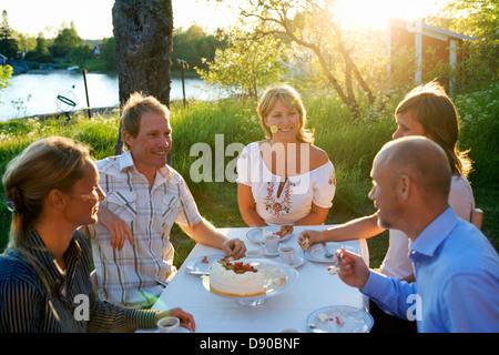 Five friends haveing a cake, Fejan, Stockholm archipelago, Sweden.