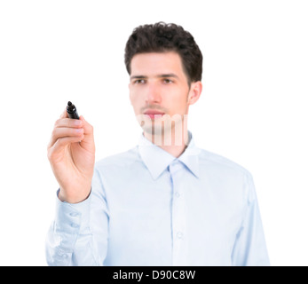 Portrait of a young pensive businessman holding a marker and writing on the empty copyspace. Isolated on white background. - Stock Photo