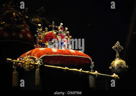 The Crown of Saint Wenceslas and the Royal Apple and Sceptre displayed at the exhibition of the Czech Crown Jewels. - Stock Photo