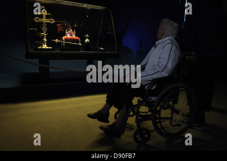 A visitor on a wheelchair examines the Czech Crown Jewels on May 10, 2013. - Stock Photo