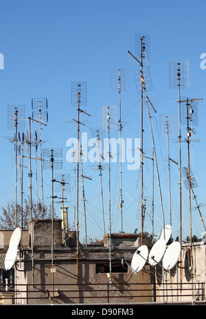Many home TV antennas mounted on a roof - Stock Photo