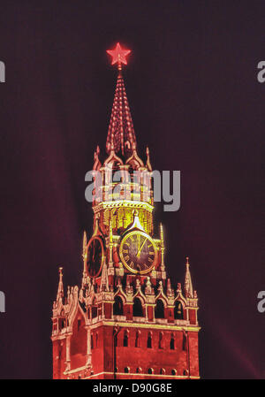 May 1, 1987 - Moscow, RU - The Savior Clock Tower (Spasskaya Tower), with the Illuminated red star at its apex, - Stock Photo