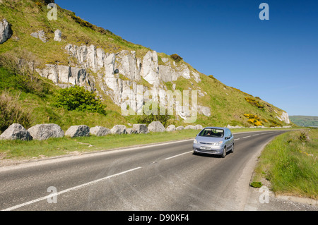 Causeway Coastal Route outside Glenarm, seen as many as one of the best driving roads in the world. - Stock Photo