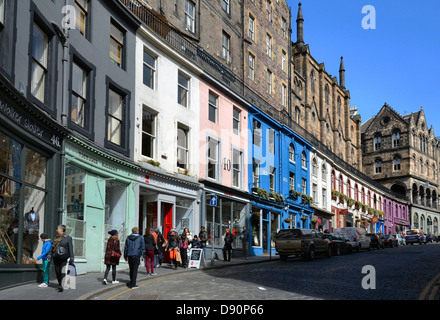 Colourful shops line Victoria Street in Edinburgh's Old Town. - Stock Photo