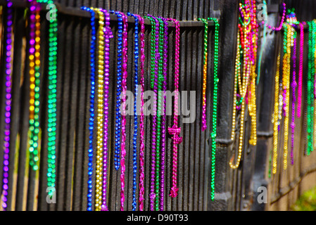 Beads on a fence after Mardi Gras in New Oleans, LA - Stock Photo