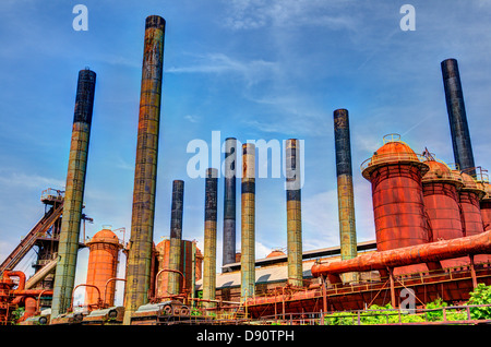 Smoke stacks of an old factory. - Stock Photo