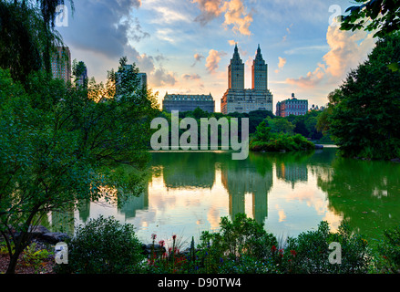 Upper West Side skyline from Central Park Lake in New York City. - Stock Photo