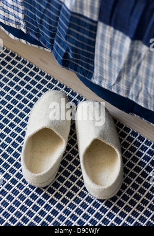 Pair of sleepers near bed - Stock Photo