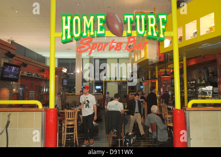 Los Angeles California International Airport LAX concourse gate area terminal Home Turf Sports Bar front entrance - Stock Photo