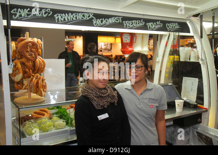 Germany Frankfurt am Main Airport FRA terminal gate area concourse shopping retail display for sale pretzels sausages - Stock Photo