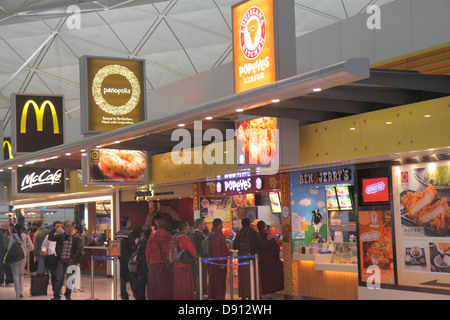 Hong Kong China International Airport HKG terminal concourse gate area inside interior food court Popeye's Panopolis - Stock Photo