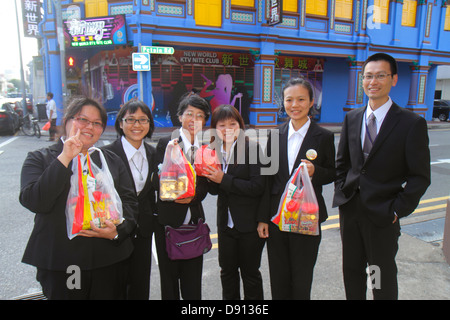 Singapore Little India Jalan Besar street scene shophouses Asian man woman shoppers - Stock Photo
