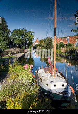 Canal with sailboat in Edam, Holland, Netherlands, Europe - Stock Photo