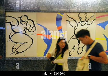Singapore Farrer Park MRT Station subway train public transportation commuters riders Asian man woman couple public - Stock Photo