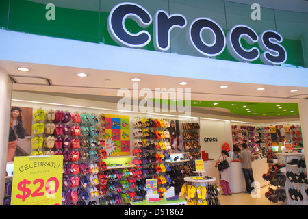 Singapore The Shoppes at Marina Bay Sands shops shopping front entrance fashion Crocs shoes - Stock Photo