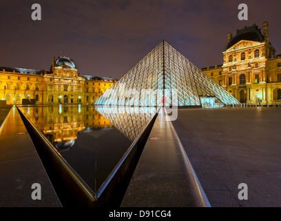 Louvre museum at night, Paris, France - Stock Photo