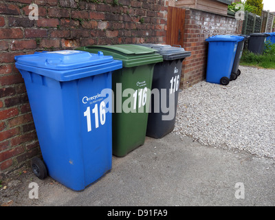 The many wheelie bins now required for domestic households in England, UK Blue for recycling, Green Garden Waste, - Stock Photo