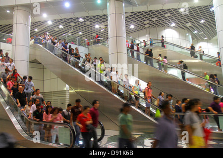 Singapore Dhoby Ghaut MRT Station North South Line subway train public transportation escalator riders commuters - Stock Photo