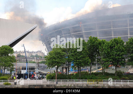 Hydro, Glasgow, Scotland, UK. 8th June 2013. Fire takes a firm hold at the unfinished Hydro arena. Fire spread through - Stock Photo