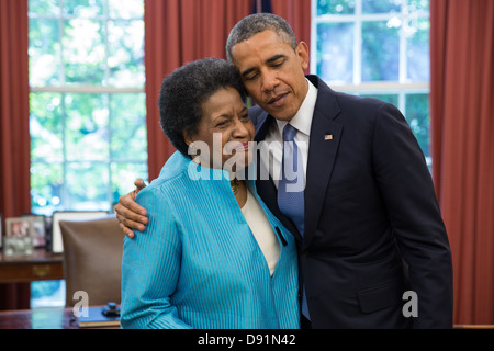 President Barack Obama embraces Myrlie Evers-Williams during her visit in the Oval Office, June 4, 2013. The President - Stock Photo