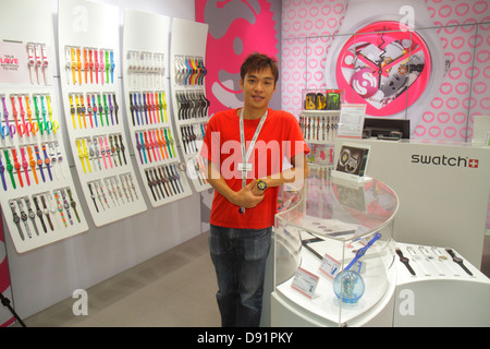 Singapore Bishan Place Junction 8 shopping mall complex front entrance Asian man employee salesman Swatch watches - Stock Photo