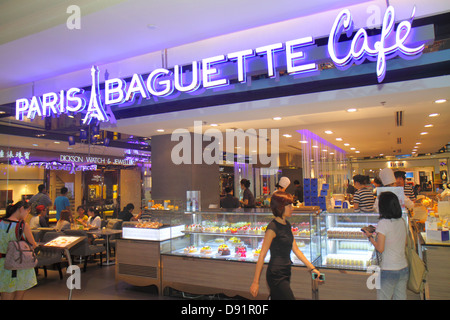 Singapore Orchard Road Ion Orchard mall complex upscale shopping Paris Baguette Cafe restaurant dining Asian woman - Stock Photo